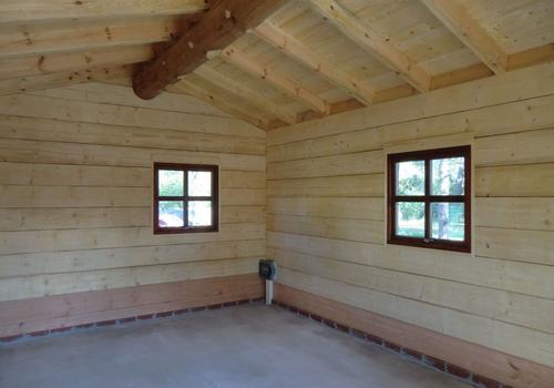 Die Blockhausbauer - Halbstammblockhaus mit großzügigem Innenraum